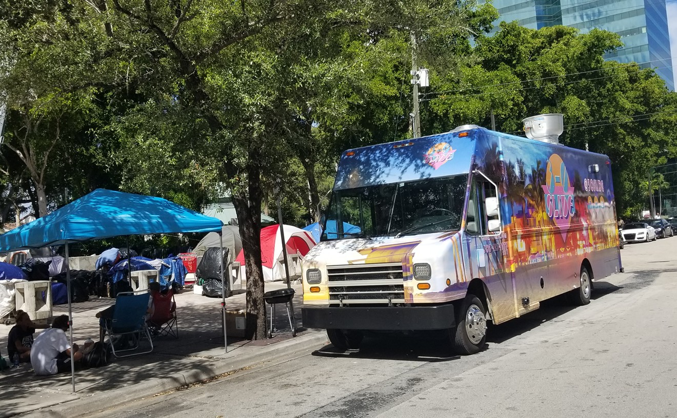 The 3-0 Slide truck recently parked at the homeless camp near Fort Lauderdale's Main Library to feed more than 85 folks.